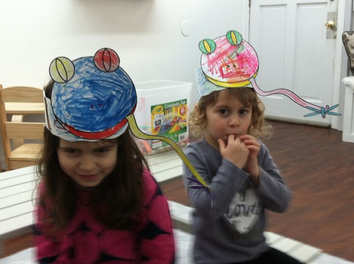 Girls wearing handmade Frog Hats we created together at Little Bee Learning Studio in Hoboken