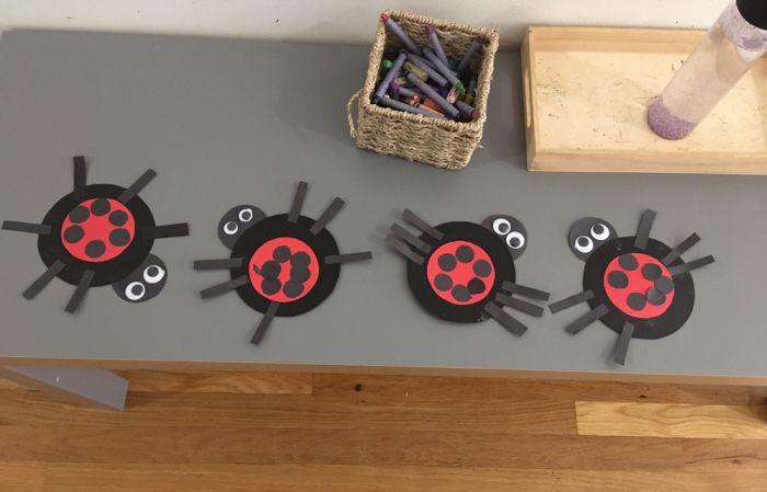 art students create little ladybugs