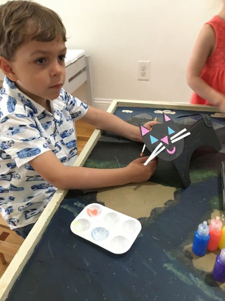 art student creates 3d black cat