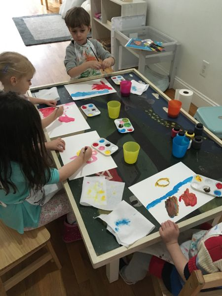 young students painting at Little Bee Learning Studio