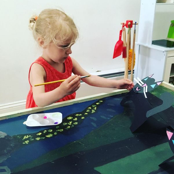 young student painting 3d cat
