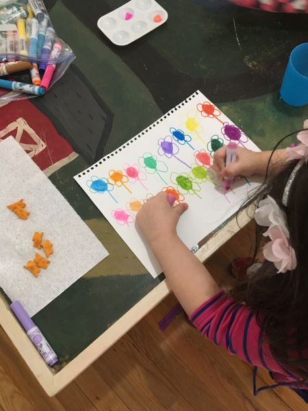 young student drawing flowers