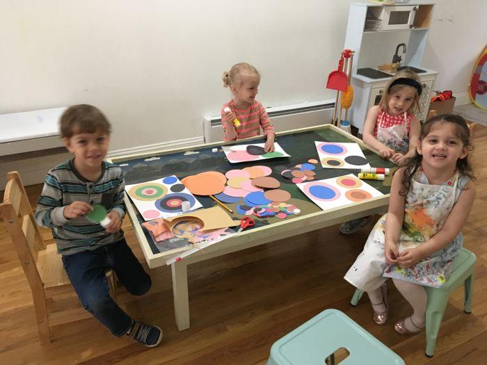 young students creating circle art