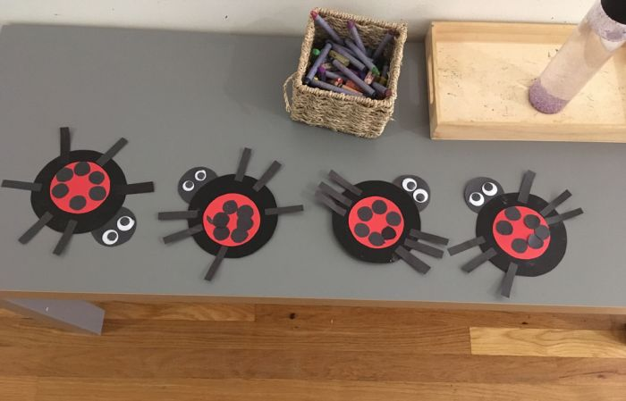art students create little ladybugs