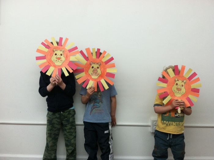 3-lion-masks-with-boys-at-peaceful-frogs-class-hoboken